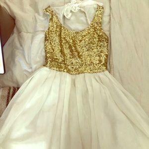 White till dress with gold sequins on top!
